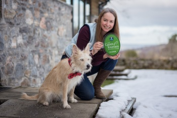 Jane, the owner, with Emma showcasing the Silver Award from Green Tourism (now Gold)